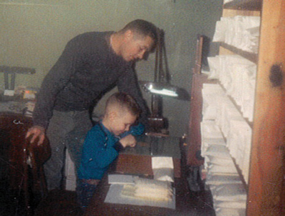Jim Girardin Sr. with Jr. in the seed lab, 1966.