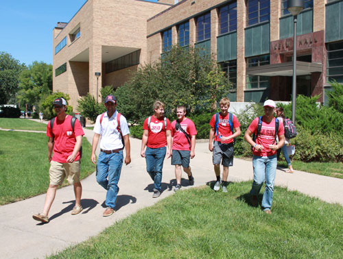 Undergraduate students walking by Keim Hall and Plant Sciences Hall