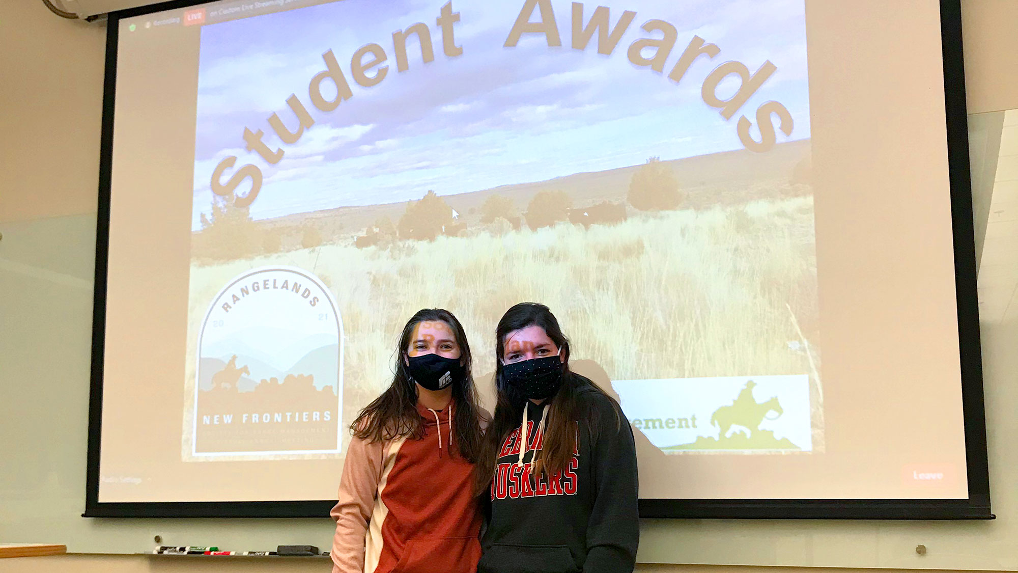 Asha Scheideler (left) and Kaitlyn Dozler celebrate Dozler's win during the Range Management Club's 2021 virtual awards ceremony watch party in February.