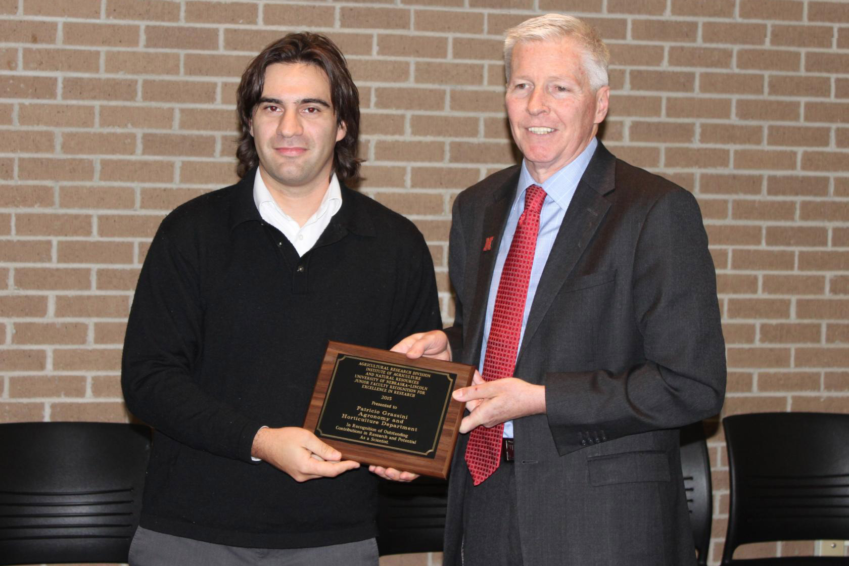 Grassini (left) honored with the Junior Faculty for Excellence in Research Award given by ARD Dean Archie Clutter.