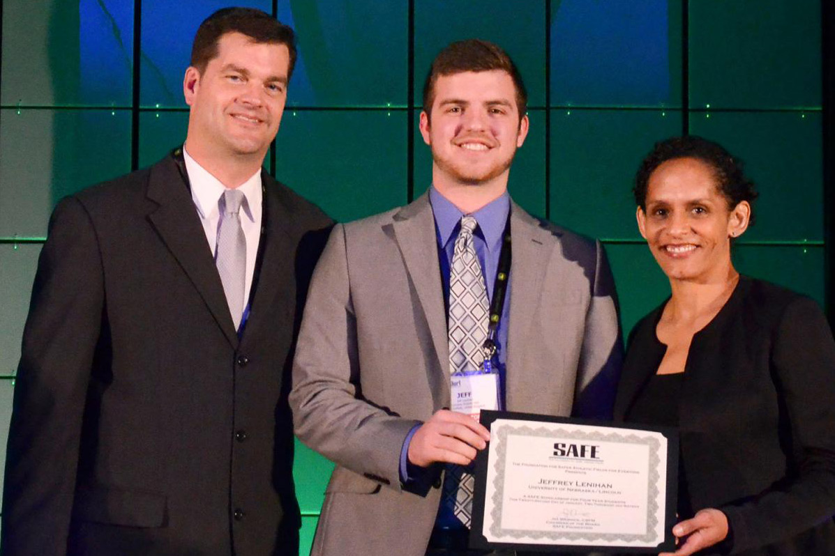 Jeff Lenihan (middle) is awarded a SAFE scholarship, at the Sports Turf Managers Association national conference.