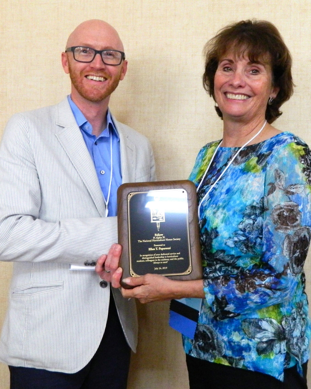 Ellen Paparrozi, right, accepts the Pi Alpha Xi Fellow award from Ryan Contreras, President of Pi Alpha Xi National.