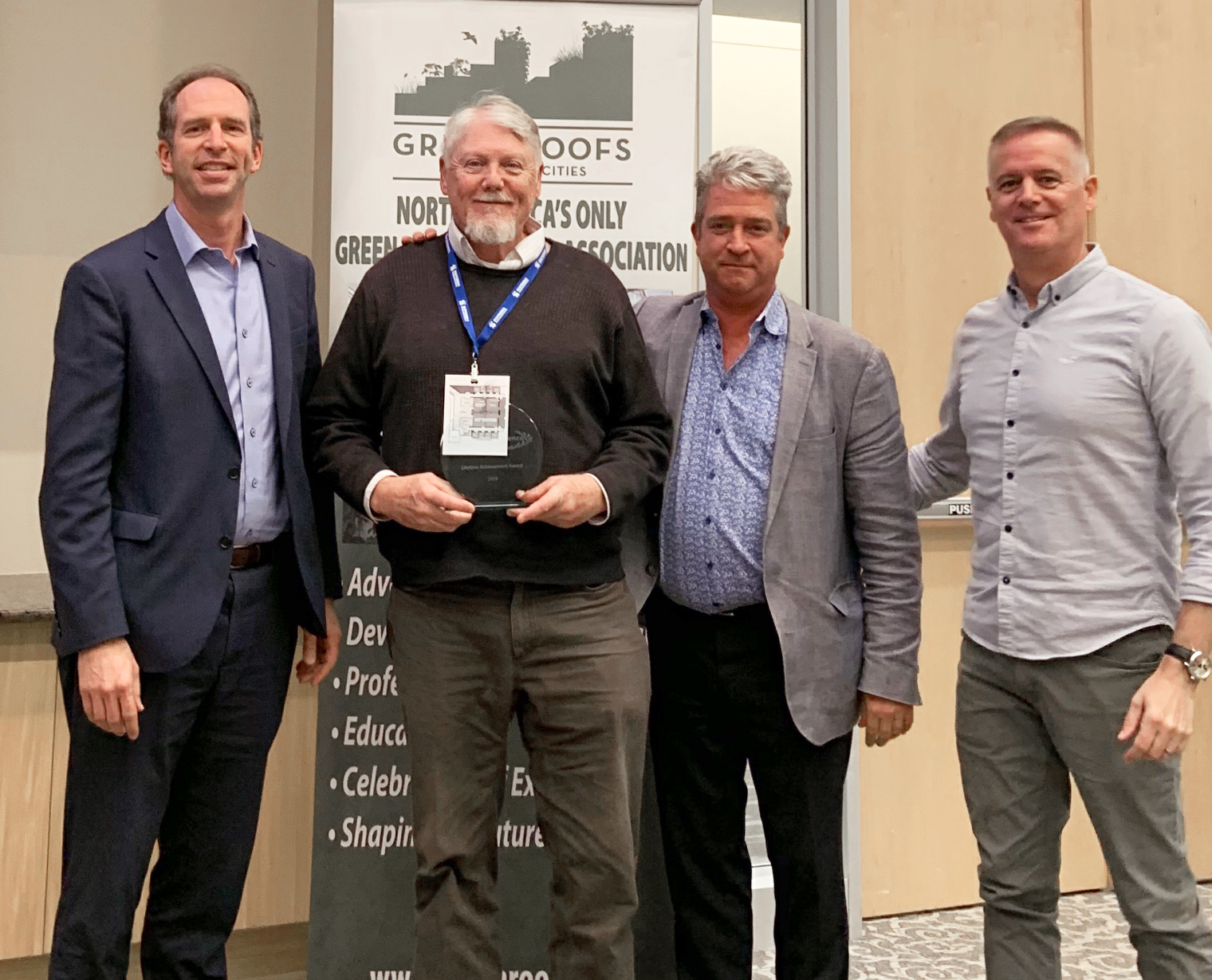 Richard K. Sutton (second from left) receives the Career Research Award in Green Roof Research from Green Roofs for Healthy Cities Research Committee Chair Reid Coffman (left), Green Roofs for Healthy Cities CEO Steven Peck (third from left) and Gray to Green Conference Chair Joe Barmore (right) Oct. 29 at the Gray to Green Conference in Washington, D.C.