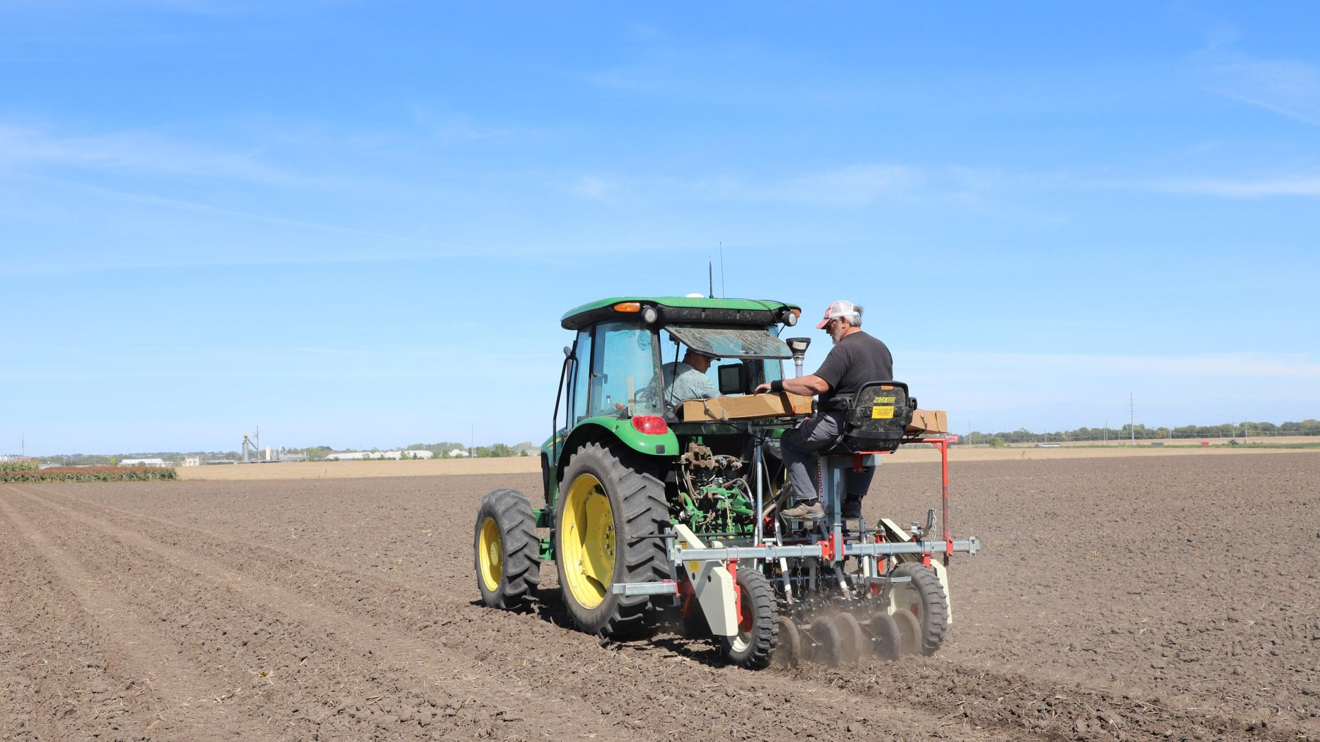 Mitch Montgomery and Greg Dorn plant winter wheat at Havelock Farm