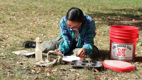 Phuong Minh Tu Le makes notes about her soil texture and soil color determinations during an Oct. 2 practice session in advance of the Region 5 Soil Judging Competition. The competition is being held virtually this year. Lana Koepke Johnson, Department of Agronomy and Horticulture