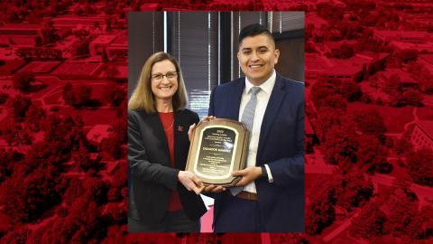 Betty Walter-Shea, CASNR interim associate dean (left), presents Salvador Ramirez with the Holling Family Teaching Assistant Teaching Excellence award March 11 at the Nebraska East Union.