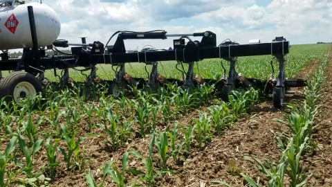 Agricultural Flaming Innovations developed equipment that uses heat for certified organic weed control. When mounted to a tractor, it directs propane-fueled flames at weeds, which wilt and die — leaving crops unaffected.