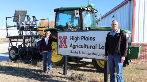 Amanda Easterly and Cody Creech stand by the High Plains Ag Lab office and research building.