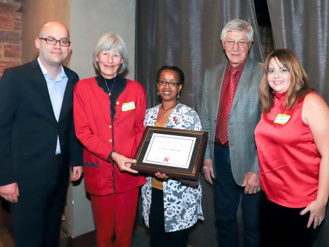 Martha Mamo, center, and Raymond Ward, second from right, present award to A. Bruce Maunder's family.