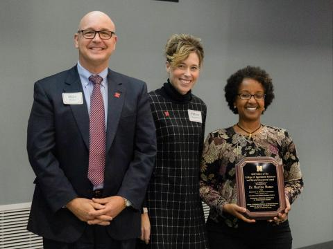 IANR Vice Chancellor Michael Boehm, left, CASNR Dean Tiffany Heng-Moss and Martha Mamo.