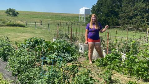 The Biggest Grower participant Shauna Radant of Team Kohlrabi shows off her competition garden near Valentine, Nebraska, this summer.