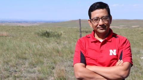 Bijesh Maharjan stands in front of a pasture north of Scottsbluff consisting of native soil and plant communities. His concept would define Soil Health Gap as the difference between soil health in an undisturbed native virgin soil and soil health in a given agroecosystem, such as a tilled field. David Ostdiek  | Communications Specialist Panhandle REC