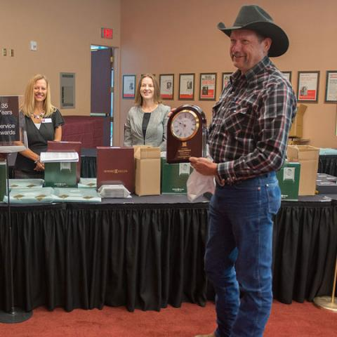 Michael Wilford poses with his 35 years of service honor