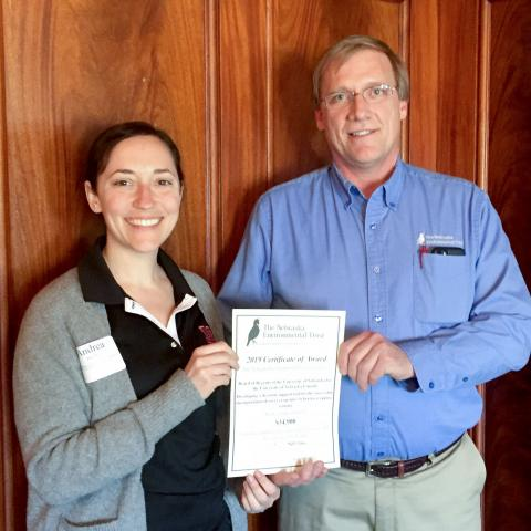 Andrea Basche, left, receives a grant from Mark Brohman, Executive Director of the Nebraska Environmental Trust.