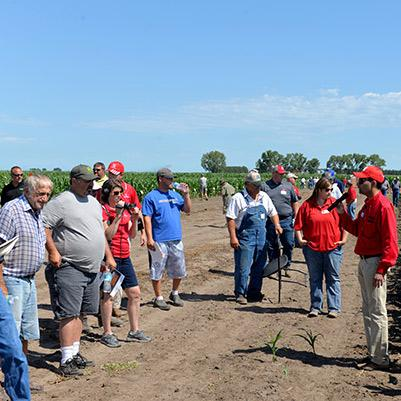 Amit Jhala, Nebraska Extension Weed Management Specialist discusses a project with Field Day