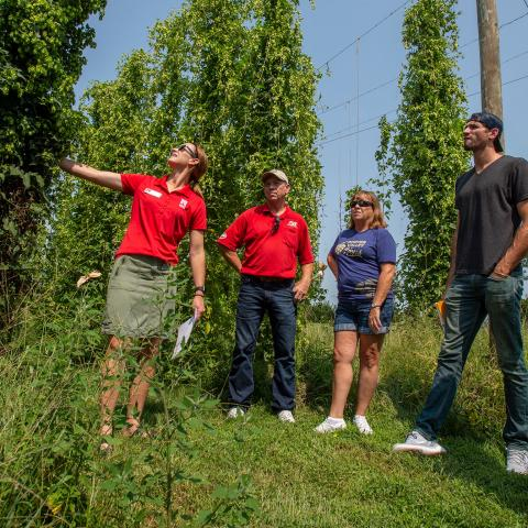 Katherine Kreuser (left) talks about growing hops