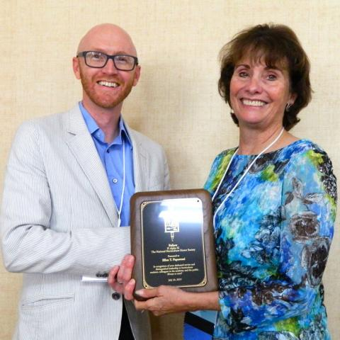 Ellen Paparrozi, right, accepts the Pi Alpha Xi Fellow award from Ryan Contreras, Associate Professor at Oregon State University and President of Pi Alpha Xi National.